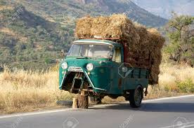Defective Old Three Wheel Truck With Hay Load On The Road On.. Stock ... Kims County Line In Its Hday Small Hay Truck Stock Image Image Of Biological Agriculture 14280973 Truck Hauling On Farm With Family Help Men Riding Trailer Full With Bales Of Hay Straw Free Stock Photo Public Domain Pictures Hauling Bmt Members Gallery Click Here To View Our Members A Large Central Washington State Delivers Winter Crownline Beds Farm Source Sales Old Rusting Vintage Full Pumpkins And 2009 Dodge Feed Hydraulic Spike T S Feeder