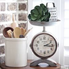 This Vintage Style Scale Clock Is Perfect For Your Farmhouse Kitchen Its Made Of Metal With A Rustic Finish It Features Functioning Face On Each
