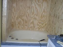 tub shower combo ideas wood textured floor tiled mosaic