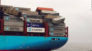 Containers Lay Damaged And Precariously Perched On The Deck Of Ship