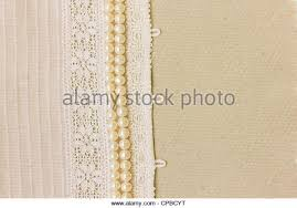 Aged Wedding Background With Lace And Pearl Beads