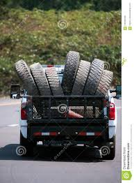 Truck Carry Big Rig Semi Trucks Old Used Tires On The Road Stock ... Michelin Defender Ltx Ms Delivers Strong Lolasting Tire For Pics Of Big Ass Trucks On Tractor Tires Page 13 Chevy Truck Dodge Pickup Trucks Ram With Big Tires Yrhyoutubecom Gas How Much Does A New Set Cost Tirebuyer Tirebuyercom What Are Right Your At Brdwayautoandtirecom Shop Commercial In Houston Tx Allseason Light Firestone Transforce Ht You Need To Know Before Tow Choosing The Right For Iconfigurators Fuel Offroad Wheels 1954 54 Chevrolet 3100 Candy Blue With Rims