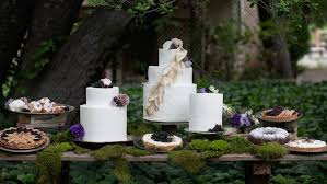 Outdoor Wedding Reception Dessert Table With Moss White Cakes Pies And Teacakes