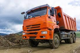 100 Dump Trucks Videos Truck Rides On The Mountain Road Under Construction Stock Photo