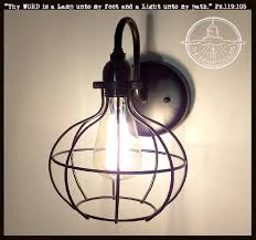 cage industrial wall light sconce with edison bulb the l goods