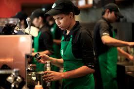 Employees Work Inside The Starbucks At Taj Mahal Palace Hotel In South Mumbai