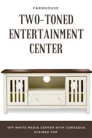 Farmhouse Style Two Toned Entertainment Center Perfect For Holding All Your Media Items While Still Looking Rustic