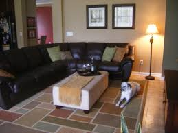 Black Leather Couch Decorating Ideas by Black Leather Sofa And Rectangle White Table On Assorted Color Rug