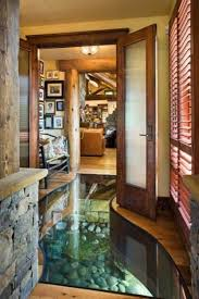 Glass Floor With Water And Rocks Underneath Interesting