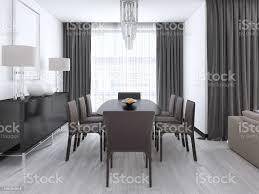 luxuriöse moderne esszimmer mit einem großen tisch und gepolsterten stühlen und kristallkronleuchter über stockfoto und mehr bilder architektur