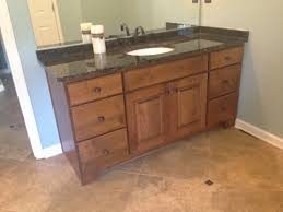 Delta Dryden Faucet Stainless by Alder Cabinet With Verde Butterfly Granite And Delta Dryden Faucet