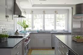 light gray kitchen cabinets with black countertops kitchen