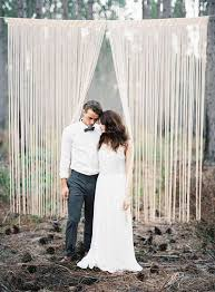 Fringe Backdrop Hanging From Tree Branch For Forest Wedding Ceremony