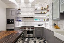 white cabinets with gray countertop dark brown brick backsplash