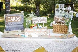 Design A Rustic Welcome Table At Your Wedding Reception Using Antique Wooden Furniture