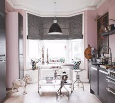 A Kitchen With Dark Appliances And Walls In Light Pink Paint Color Used Paper Library Suchong Pure Flat Emulsion