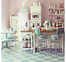 Retro 50s Kitchen Decor With Pink Refrigerator And White Wooden Corner Shelves Facing