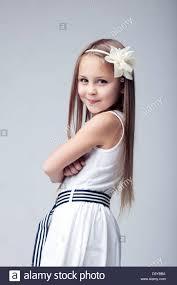 pretty blonde girl in white dress stock photo royalty free