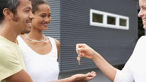 Realtor Handing House Keys To A Couple