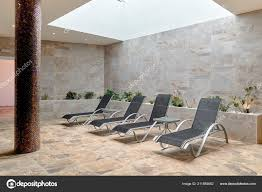 Empty Four Gray Lounge Chairs Tiled Room Nobody Spa Room ... Tivolitailnteriordesignloungebathcinema Run For Hepburn Outdoor Lounge Chair Products Bed Bath And Beyond Lounge Chairs 28 Images Buy Your Eames Replica Now Its About To Covers Depot Plastic Ding Bath Cushions Big Menards Chairs Sferra Santino Terry Towel Cover Grand Lake N More Beach Style Stripe Chaise Fniture Long Sofa Cushion Dogs Twin Topper Beyond All Keeping Contour Knee Details 2pc Folding Zero Gravity Recling Patio Yard Khaki Portable Tie Dyeing Us 1626 27 Offchair Microfiber Pool With Pockets Quick Drying 825x28in