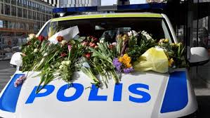 People Left Flowers On A Police Van Outside Ahlens Department Store Following The Terror Attack In