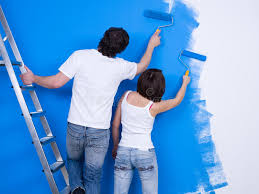 Download Couple Of People Painting The Wall Stock Image