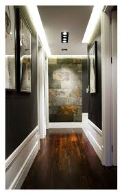 Love The Wall Color Dropped Panel Lighting On Ceiling Stone Accent And Rich Warm Wood Floor