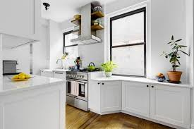Above A Full Line Of Cabinets Dominate One Wall In This Galley While The Windowed Is Kept Fairly Open Right Windowsill Was Eliminated