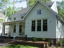 Just Love This New Farmhouse Style Home With Batten Board Siding And Brick Foundation Planter