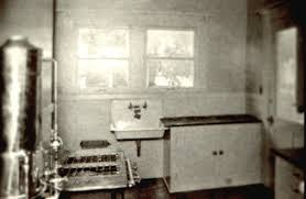 An Early Photograph Of A Kitchen With Gas Burning Range Connected To Hot Water
