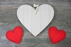 Rustic Wooden Heart And Red Roses Over Background For