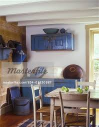 DINING ROOMS Log Cabin Exposed Painted White Beams Distressed Primitive Blue Dry Sink With Large Wooden Bowls Hanging Cabinet