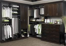 spare bedroom into walk in closet l shaped light brown particle