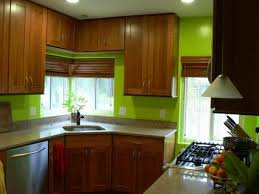 light green kitchen paint color with brown varnished oak wood
