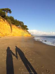 100 Butterfly Beach Shadow Of A Woman And Man Holding Hands At In