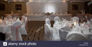 Wedding Reception Room In A Hotel With Round Guest Tables With White ... Regal Fniture How To Plan Your Wedding Reception Layout Brides Syang Philippines Price List For Usd 250 Simple Negoation Table And Chair Combination Office Chair Conference Table And Chairs Admirable Round Ikea Business Event Seating Arrangements Whats The Best Your Event Seating Setting Events Budapest Party Service Tables Chairs Negotiate A Square Four Indoor Flowers Stock Photo Edit Now