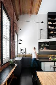 100 Loft Apartments Melbourne Apartment With A Brick Wall And Bright Furniture In
