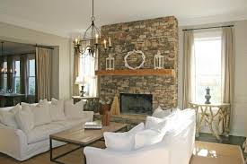 Stone Fireplace In White Living Room Wall With Sofa