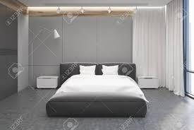 graue und weiße schlafzimmer interieur mit einem betonboden ein großes bett mit einem weißen deckel und zwei nachttische 3d rendering mock up