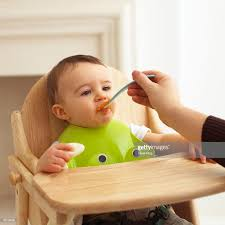 Baby Boy In High Chair Being Spoonfed Wearing Plastic Bib Closeup ... Baby Wearing Blue Jumpsuit And White Bib Sitting In Highchair Buy 5 Free 1classy Kid Disposable Bibs Food Catchpocket High Chair Cover Sitting Brightly Colored Stock Photo Edit Now Micuna Ovo Review Fringe Bib Tutorial Baby Fever Tidy Tot Tray Kit Perfect For Led Weanfeeding Pearl Necklace Royaltyfree Happy On The 3734328 Watermelon Wipe Clean Highchair Hugger 4k Yawning Boy Isolated White Background Childwood Evolu 2 Evolutive Kids