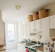 Decorating Above Kitchen Cabinets With Baskets