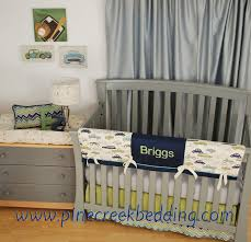 Navy crib bedding with Cars and Green Chevron and grey in the
