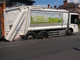 Bin Lorry Sinks Into Road As Street Melts In Soaring Temperatures ...