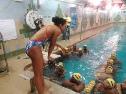 Olympic Swimmer Lia Neal Dives in at the Bed Stuy YMCA