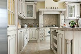 French Country Kitchen With Antique White Cabinets And Glass Doors