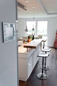 kochinsel küchentraum in hochglanz weiß mit theke und