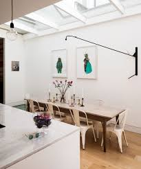 Modern Dining Area With Statement Lighting Small Room Ideas