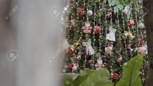 Gimbal Shot Of Ornaments On Christmas Tree With Decorative Light And Front