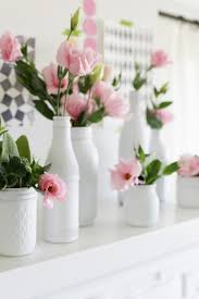 All The Pretty Things Pink Flowers In White Painted Vases Made From Regular Bottles And Jars