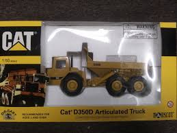 100 Articulated Truck Buffalo Road Imports Caterpillar D350D Dump
